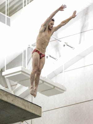 David Boudia, practices a dive during a Pre-Olympic Trials news conference as members of the media film at Purdue University's Boilermaker Aquatics Center, Wednesday June 8th, 2016.