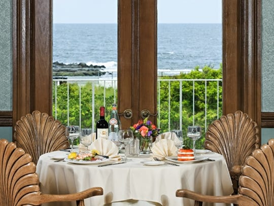 The Seashell Dining Room overlooks the ocean.
