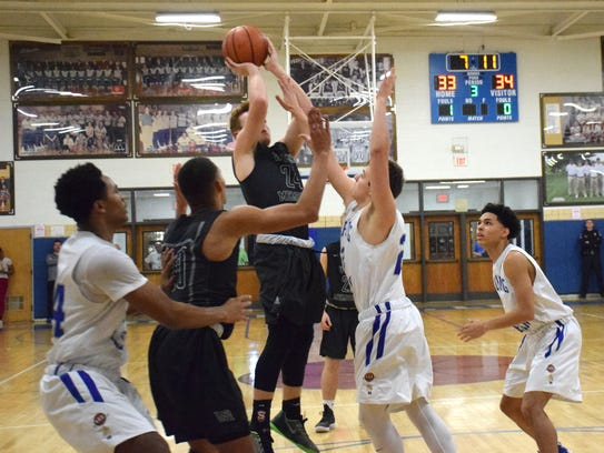 Wilson Memorial's Jacob Sears takes a jumper in the