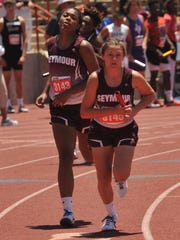 Seymour's Triana McGee (left) hands the baton off to Sidney Tucker during the Lady Panthers' 4x200 relay Saturday in Austin.