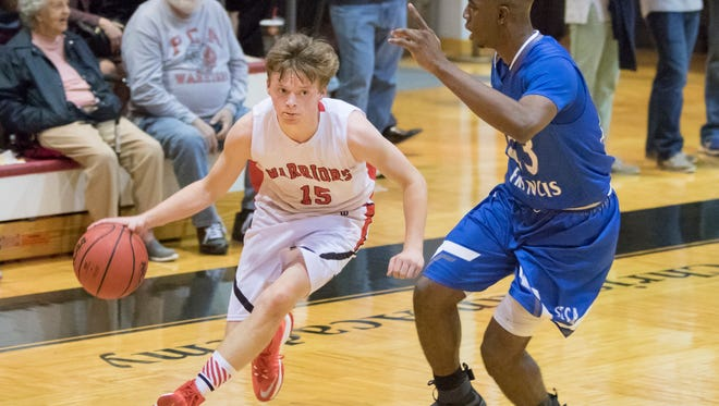 Austin Lewis, shown in a game last season, has led the Pensacola Christian Academy boys basketball team to a fast start.