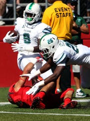 Tulane wide receiver Teddy Veal (9) is tackled by Rutgers
