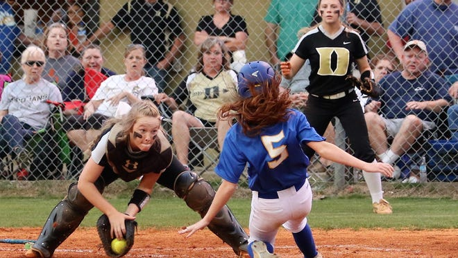 McNairy Central's Megan Hodum slides safely into home plate during the Lady Bobcats' 2-1 win over Dyersburg in the Region 7-AA championship game on May 16.