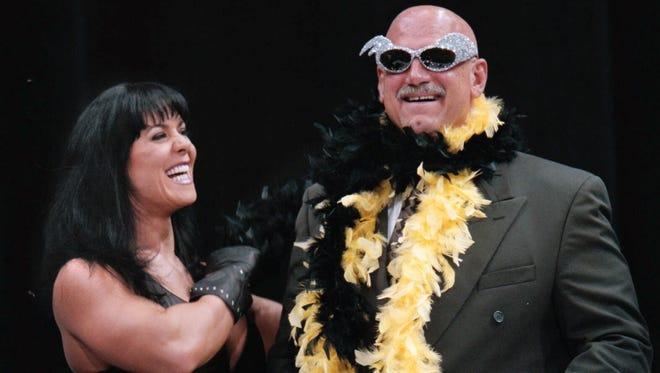 "Minnesota Gov. Jesse Ventura is adorned with his signature feather boa and glitter sunglasses by professional wrestler Chyna Wednesday July 14, 1999, during a World Wrestling Federation press conference at the Target Center in Minneapolis. Ventura, who wrestled under the name Jesse ""The Body"" Ventura, announced to a crowd of screaming fans that he will return to the ring as a guest referee at WWF's SummerSlam '99 in Minneapolis August 22, 1999, to bring ""law and order"" back to wrestling."