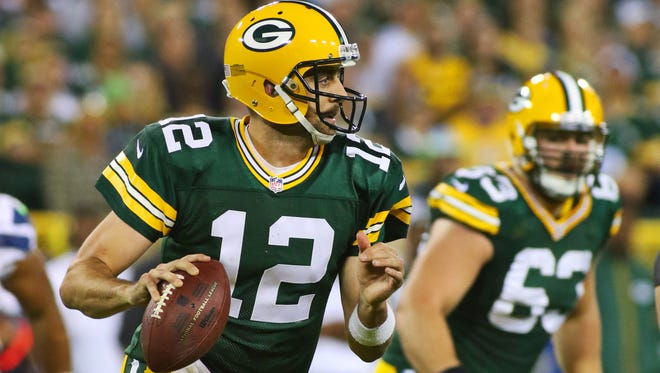 Packers QB Aaron Rodgers threw three TD passes Sunday.