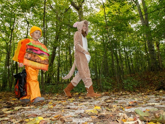 """Jace Trinkle, 4, and his sister Rylee, 11, collect candy during the """"Trek 'n Treat"""" at Grant Park in South Milwaukee on Sunday, Oct. 15, 2017. The event, hosted by the Friends of Grant Park, offered participants the opportunity to """"view the haunts of nature"""" on an educational trek along the Seven Bridges Trail."""