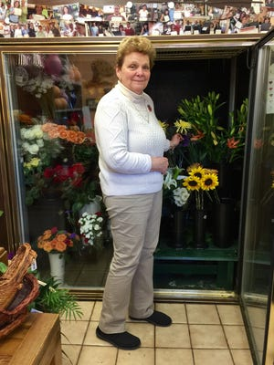 Rene Bellott stands in her flower shop in Parsippany where, she says, parking is a problem.