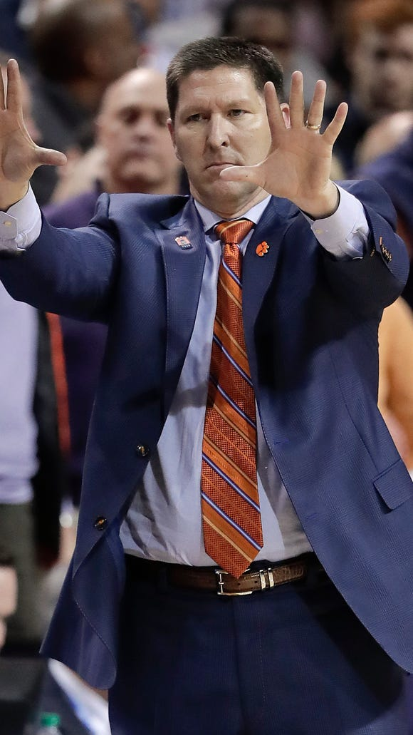 Clemson coach Brad Brownell motions to players during the second half of the team's NCAA college basketball game against Virginia in the Atlantic Coast Conference men's tournament semifinals Friday, March 9, 2018, in New York. Virginia won 64-58. (AP Photo/Julie Jacobson)