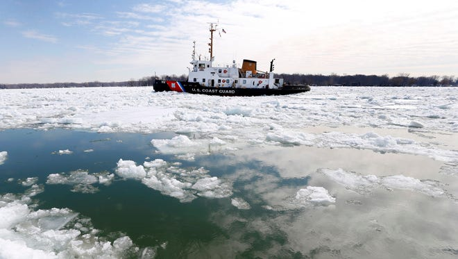 The U.S. Coast Guard's 140-foot icebreaking cutter Bristol Bay breaks up ice that remains on some Great Lakes shipping channels in the St. Clair River near Algonac, Mich., Friday, March 20, 2015.
