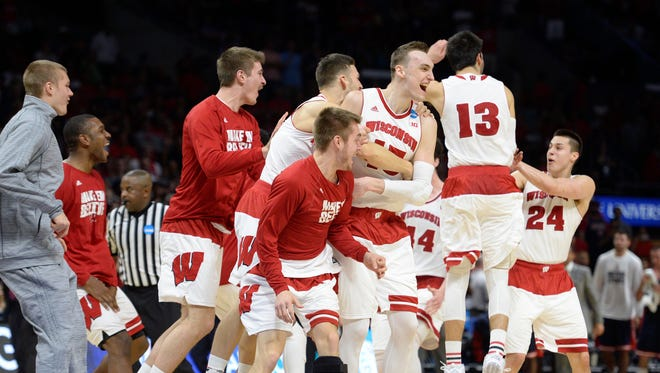 Mar 28, 2015; Los Angeles, CA, USA; Wisconsin Badgers players celebrate the 85-78 victory against Arizona Wildcats following the second half in the finals of the west regional of the 2015 NCAA Tournament at Staples Center. Mandatory Credit: Robert Hanashiro-USA TODAY Sports