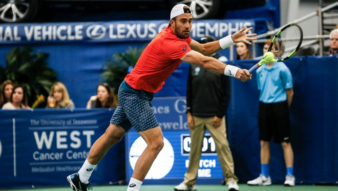 Steve Johnson returns the ball against Taylor Fritz during the fourth day of the 2016 Memphis Open at the Racquet Club in East Memphis on Feb. 11, 2016.