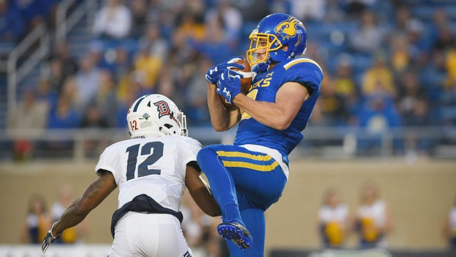 SDSU Jake Wieneke completes the pass for a touch down  against Duquesne University Thursday in Brookings.