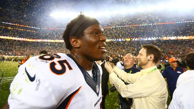 Confetti falls as Denver Broncos tight end Virgil Green celebrates after his team defeated the Panthers in Super Bowl 50.