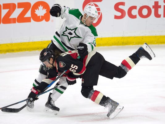 Dallas Stars right wing Adam Cracknell (27) collides with Ottawa Senators defenseman Erik Karlsson (65) during third-period NHL hockey game action Thursday, Feb. 9, 2017, in Ottawa, Ontario. (Adrian Wyld/The Canadian Press via AP)