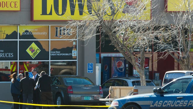 Las Cruces police talk with witnesses following a fatal officer-involved shooting in front of the Lowe's grocery store at 1410 Missouri Ave., on Tuesday, January 24, 2017.