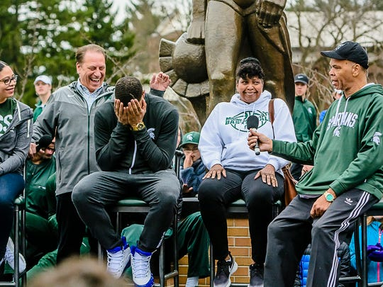 MSU freshman Miles Bridges, center, reacts after his father Raymond, right, said that his game was better then that of his friend Josh Jackson of Kansas at a press conference at the Sparty statue Thursday