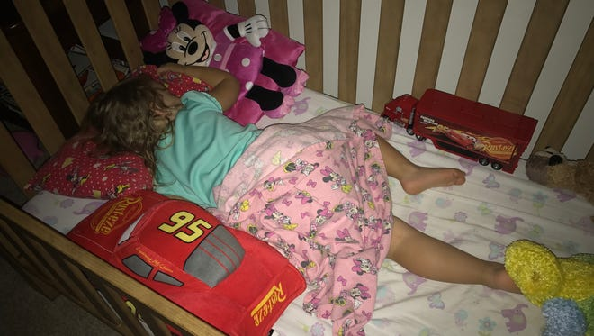 Isabella sleeps soundly in her big-girl bed. She had previously refused to use it after its conversion from a crib to a bed.