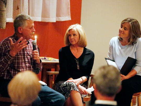 In this Friday, Oct. 23, 2015, photo, Carl Mueller, left, and Marsha Mueller, parents of slain hostage Kayla Mueller, answer questions from from the Rev. Kathleen Day, right, during an event at Northern Arizona University, in Flagstaff, Ariz.