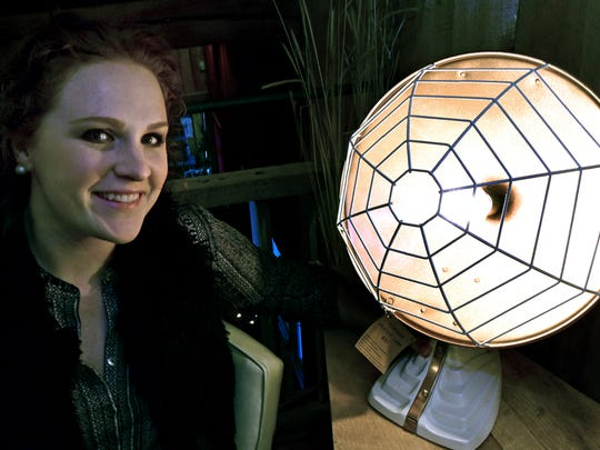 Kendra Matusiak, of REmix Design, shows off her upcycle heater lamp in her section of  Vintage Market at the Old Red Barn, Chambersburg. Matusiak will be featured on Flea Market Flip on GAC on the HGTV channel.
