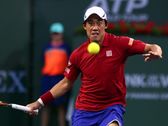 Kei Nishikori of Japan chases down a ball from American John Isner on Wednesday, March 16, 2016 during the BNP Paribas Open in Indian Wells, Calif. Nishikori won 1-6, 7-6(2), 7-6(5).