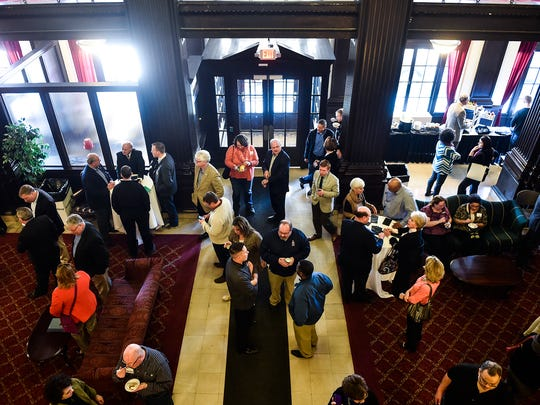 Attendees to the Chamber of Commerce's 100 year celebration mingle in the lobby of the Harding Centre on Friday.