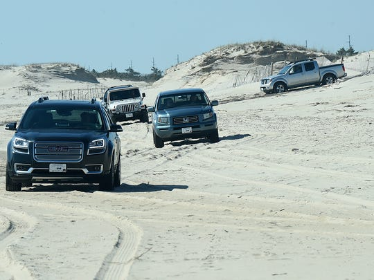 Participants in a driving on the beach class try out their new skills in a practice drive at Delaware Seashore State Park Saturday.