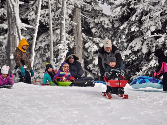 Hurricane Ridge's sledding hill is a popular, low-cost winter destination for families.