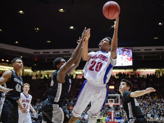 Las Cruces High's RJ Brown,right, puts a shot over