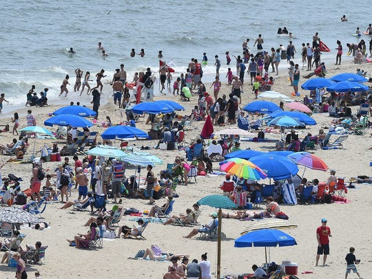 Last year, cool weather kept visitors out of the water in Rehoboth Beach. But there was a crowd on the beach and boardwalk.
