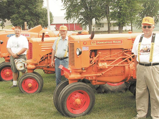Minneapolis Moline tractors were a passion among the generations in the Hull family of Waupun. In this 2002 photo, Rick Hull (left) displays his 1957 five star refurbished Minneapolis Moline tractor while his uncle, Bob Hull, (center) shows his 1946 Model R and his father, Elton Hull, his 1953 ZA.