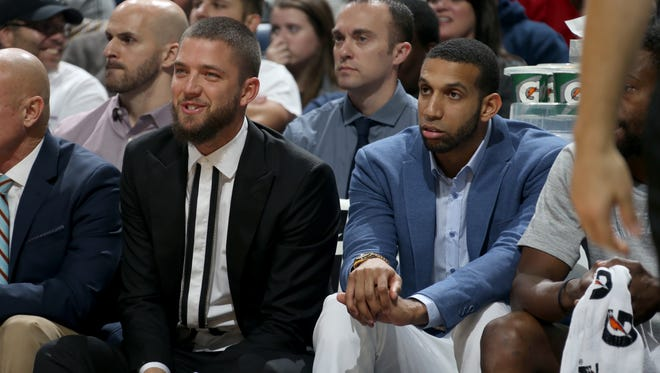 Memphis Grizzlies' Chandler Parsons (left) and Brandan Wright watch the game against the Cleveland Cavaliers.