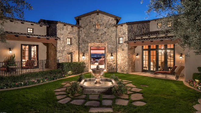 William Cobb, CEO of H&R Block, Inc. and his wife, Carole, paid cash for this 7,454-square-foot Spanish-style hacienda in Scottsdale's Silverleaf community.