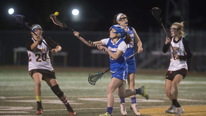 Jessica Harrison, left, of Rocky Mountain High School has been named to the girls lacrosse All-Area team.