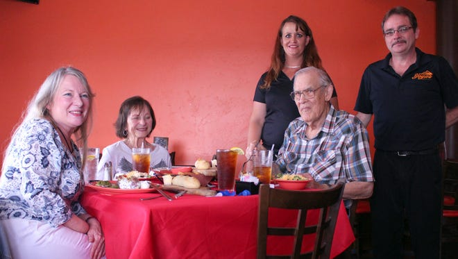 Henry Mattox (seated at right) enjoyed lunch for his 92nd Birthday at his favorite restaurant, Yoya's Bar and Grill at 1620 Columbus Road. At left are daughter Sandra Linthincom and Henry's wife, Julia Linthicom. Sandra called in a special reservation. Mattox is a decorated World War II veteran of the Army Air Corps living in Deming. Yoya's employees Brooke McWhorter and Thomas Stanley joined in for the celebration.