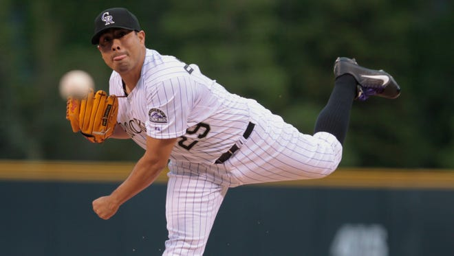 Colorado Rockies starting pitcher Jorge De La Rosa pitches against the Padres in the first inning.
