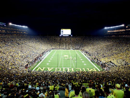 An overall of the stadium during play in the first quarter of the Michigan and Notre Dame game which is the first ever night game under the lights at Michigan Stadium in Ann Arbor on Saturday September 10, 2011.