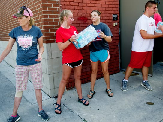 Volunteers help deliver over 500 cases of water at
