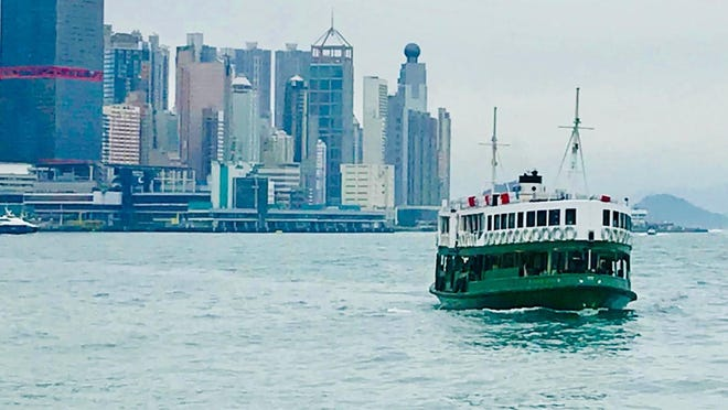 The Star Ferry floats across Hong Kong's Victoria Harbor.