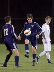 Hartland's Steven Bentley, center, made it 4-2 in favor