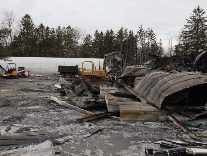 A fire destroyed a building that was used as a garage and for storage at Wayside Garden Center in Macedon on March 27, 2014.