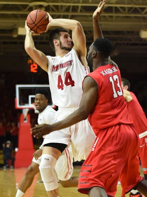 Marist College's Eric Truog looks to make a pass against Fairfield on Jan. 22 at McCann Arena.