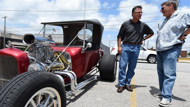 """Baxter Bulletin Editor Bob Heist (left) talks with T-Bucket owner Dave Eastman on Friday. Eastman, from Oklahoma City, gave Heist a ride in the hot rod, telling him, """"you can mark this off your bucket list."""""""