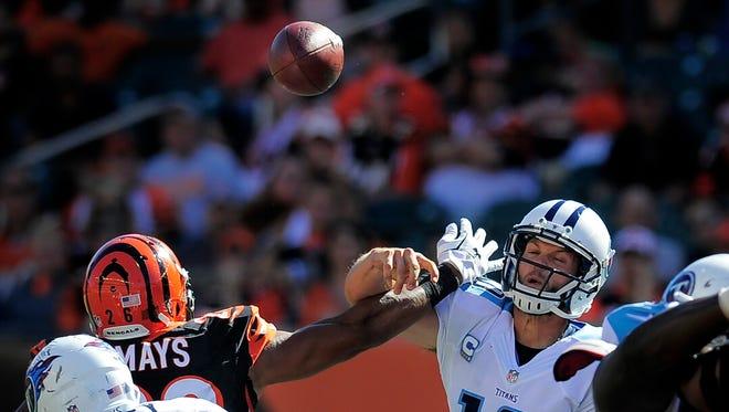 Cincinnati Bengals free safety Taylor Mays pressures Tennessee Titans quarterback Jake Locker during the fourth quarter.