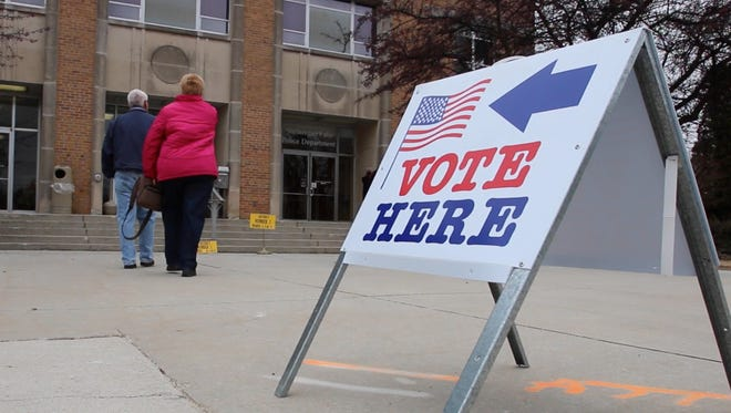 FILE -- People enter to vote at the Sheboygan Falls Municipal Building Tuesday April 1, 2014 in Sheboygan Falls.