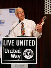 Dr. Bud Pierce asks attendees to give generously during the United Way's Community Celebration and Luncheon on Thursday, Aug. 20, 2015, at the Salem Convention Center.