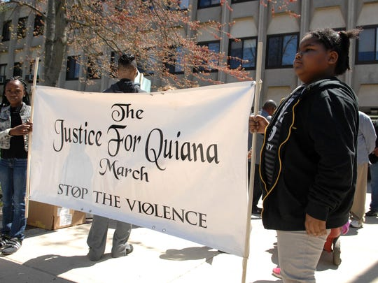 Jah'zai Rogers (left) and Dymond Moore (right) , both 7 of Asbury Park, led the 23rd annual march for Quiana Dees. Dees was shot in the head and left to die in a vacant lot near Washington Avenue and Fischer Street in 1992. No one has ever been charged with the crime.