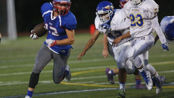 Carmel defeated Mahopac 15-14 in football action at