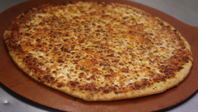 The Four Cheese pie at Chicago Pizza Factory is cooked on a New York style thin crust.
