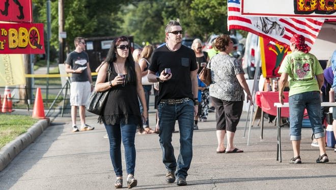 Visitors enjoy the annual Beer, Wine and Food Festival in Wyoming Proceeds benefit The Cure Starts Now.