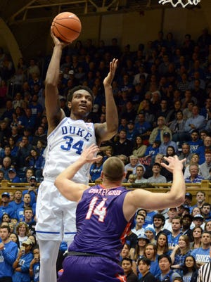 Dec 20, 2017; Durham, NC, USA; Duke Blue Devils forward Wendell Carter Jr.(34) shoots over Evansville Purple Aces forward Dainus Chatkevicius (14) during the first half at Cameron Indoor Stadium.